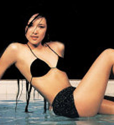 The beautiful chinese actress Zhang Ziyi is posing for FHM around a pool... wet and too sexy